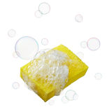 Sponge with soaps and bubbles. Yellow sponge with lots of soaps and bubbles Stock Photography