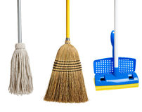 Sponge and string mop and broom on white Royalty Free Stock Images