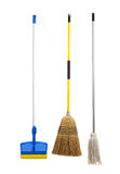 Sponge and string mop and broom on white Stock Images