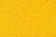 Sponge texture. Detail shot of yellow sponge extreme closeup Royalty Free Stock Photography