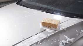 Sponge for washing cars. Car wash concept stock video footage