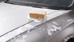 Sponge for washing cars. Car wash concept stock footage