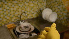 Sponge for washing dishes and gloves. stock footage