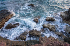 Sponge water waves on Rocks Beach, Beautiful tropical beach,Crys Royalty Free Stock Photos
