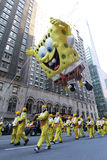 Spongebob in Macy's parade. NEW YORK CITY, NY - NOVEMBER 24: Nickelodeon Sponebob Squarepants towers over people below in Macy's 85th Annual Thanksgiving Day Royalty Free Stock Images