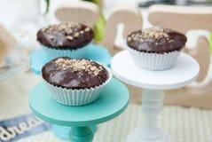 Spongecake or muffin with chocolate sauce. Three spongecake or muffin with chocolate sauce Stock Image