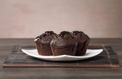 Spongecake or muffin with chocolate sauce Stock Photo