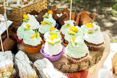 Spongecake or muffin with cream. A lot of spongecake or muffin with cream on candy bar. Set of different french colorful cookies at the fair. Very sweet dessert Stock Image