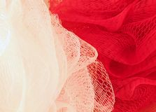 Sponges. Red and white background Royalty Free Stock Photos