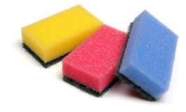 Sponges. Yellow, pink and blue kitchen sponges, isolated on a white background stock photography