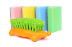 Sponges and brush. Several sponges and a brush isolated on white Royalty Free Stock Photos