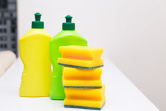 Sponges and detergent for cleaning the house  on a white table Stock Photos
