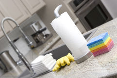 Sponges, paper towels, gloves, cloths in kitchen f. Sponges, paper towels, gloves, cloths in modern kitchen for housework stock images