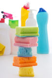Sponges and plastic bottles of cleaning products  on white Stock Photos