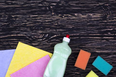 Sponges, rags and a bottle of detergent Royalty Free Stock Photography