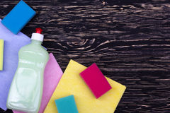 Sponges, rags and a bottle of detergent Royalty Free Stock Images