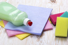 Sponges, rags and a bottle of detergent Royalty Free Stock Image