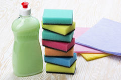 Sponges, rags and a bottle of detergent Stock Photography