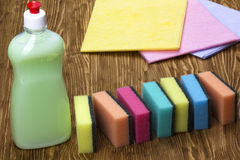 Sponges, rags and a bottle of detergent Stock Photo