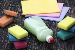 Sponges, rags and a bottle of detergent Royalty Free Stock Photo