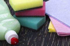 Sponges, rags and a bottle of detergent Stock Images