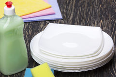 Sponges, rags, dishes and a bottle of detergent Royalty Free Stock Photo