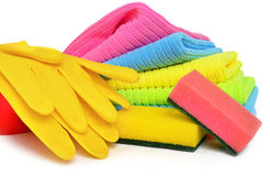 Sponges, towels and rubber gloves Stock Image