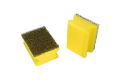 Sponges for ware washing. Two yellow sponges for ware washing. On a white background Royalty Free Stock Image