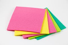 Colorful sponges in white background. royalty free stock photography