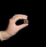 Spongious titanium nickelide. Hand in glove holding steel construction made of spongious titanium nickelide royalty free stock photo