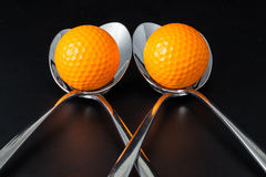 Sponns e palle da golf Fotografie Stock Libere da Diritti