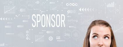 Sponsor with young woman. Looking upwards on a gray background stock images