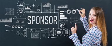 Sponsor with young woman. Writing on a blackboard stock photography