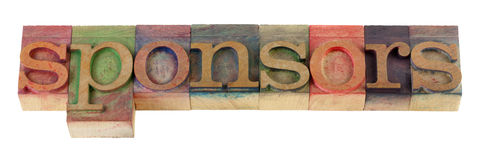 Sponsors. The sponsors word in vintage wooden letterpress type blocks, stained by color ink, isolated on white Stock Images
