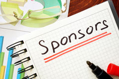 Sponsors written in a notebook. Royalty Free Stock Photos