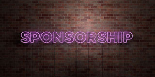 SPONSORSHIP - fluorescent Neon tube Sign on brickwork - Front view - 3D rendered royalty free stock picture. Can be used for online banner ads and direct Royalty Free Stock Photos
