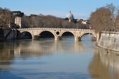 Spont of the Tiber river. In Rome with view of San Pietro`s dome Royalty Free Stock Photography