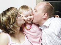 Spontaneous affectionate young family Royalty Free Stock Images
