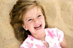 Spontaneous laughing girl Stock Photography