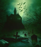 Spoody castle with graveyard down below Royalty Free Stock Photos