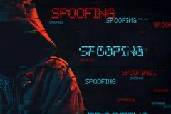 Spoofing pojęcie z beztwarzową kapturzastą męską osobą obrazy stock