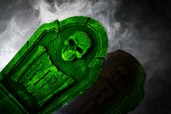 Spookey Grave Stone. Scary Halloween scene with graves and pumpkins Stock Image