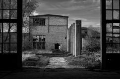 Spooky abandoned factory buildings in black and white Royalty Free Stock Photography
