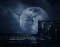 Spooky ancient building with full moon and bird, Halloween backg Royalty Free Stock Image