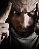 Spooky angry man with evil sinister eyes royalty free stock images