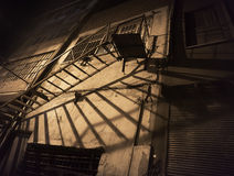 Spooky back yard with fire escape Royalty Free Stock Photos