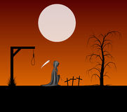 Spooky background with grim reaper with scythe in a cemetery Stock Image