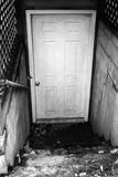 Spooky Basement Doorway. A vertical black and white image of a spooky basement doorway Stock Photography