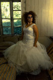 Spooky bride. Psycho woman dressed as bride in devastated room royalty free stock photography