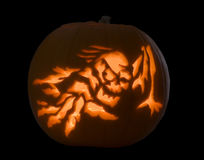 A spooky carved pumpkin. A pumpkin carved with a spooky image for halloween Stock Image